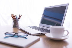 Office desk in the morning - selective focus Royalty Free Stock Photos