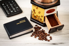 Office desk with name card holder and coffee grinder. Office desk table with name card holder, keyboard and coffee grinder with coffee beans Royalty Free Stock Image
