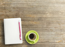 Office desk with notebook and coffee Royalty Free Stock Photo