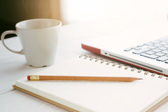 Office desk. Notes, pencil, coffee cup and laptop on the desk Royalty Free Stock Photo