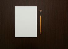 Office Desk Objects. A Sheet of Paper, a Pencil and a Pencil Sharpener royalty free stock images