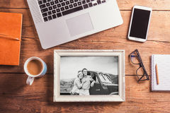 Office desk. Objects and black-and-white photo of senior couple. Office desk with various objects and black-and-white photo of senior couple in white picture Stock Images