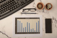 Office desk with paperwork. And statistics royalty free stock photography