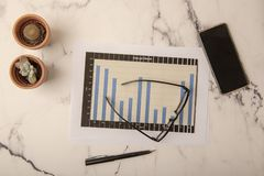Office desk with paperwork. And statistics stock photos