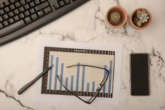 Office desk with paperwork. And statistics royalty free stock photos