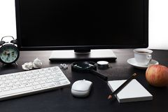 Office desk with the PC and business objects on black table. royalty free stock photo