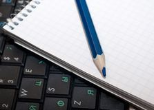 Office desk with pencil, laptop and notebook. Royalty Free Stock Photos