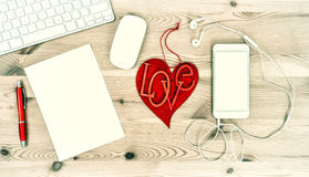 Office Desk with Red Heart, Keyboard, Phone, Headphones. Valenti Stock Photos