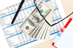 Office desk with reports, blank notepad and money cash Royalty Free Stock Photos