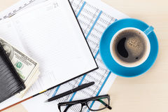 Office desk with reports, blank notepad and money cash Stock Photo