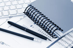 Office desk with reports, blank notepad and supplies Stock Photography