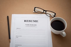 Office desk with resume information, Coffee cup, black pencil an Royalty Free Stock Image