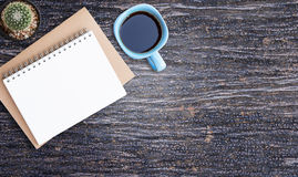 Office desk smart phone and coffee cup Royalty Free Stock Images