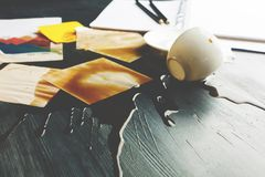 Office desk with spilt coffee closeup. Close up of office desk with supplies and spilt coffee. Trouble and problem concept Royalty Free Stock Photography