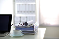 Office desk a stack of computer paper reports work Royalty Free Stock Images