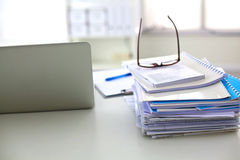 Office desk a stack of computer paper reports work Stock Images