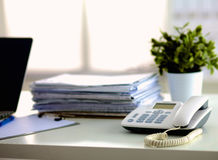 Office desk a stack of computer paper reports work Royalty Free Stock Image
