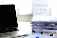 Office desk a stack of computer paper reports work Royalty Free Stock Photos