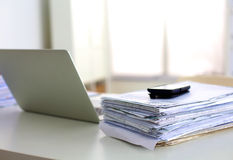 Office desk a stack of computer paper reports work Stock Image