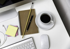 Office desk with stationaries and coffee cup Royalty Free Stock Images