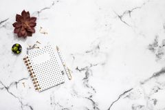 Marble table flat lay with gold stationary accessories, notebook and pen for bloggers, students, office Royalty Free Stock Images