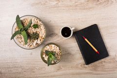 Office desk with stationary. Wooden office desk with stationary and flowerpot Royalty Free Stock Images