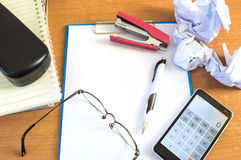 Office desk with supplies calculator pen book and glasses Stock Images