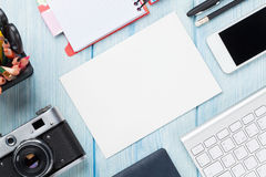 Office desk with supplies, camera and blank card Stock Photography