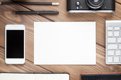Office desk with supplies, camera and blank card Royalty Free Stock Photography