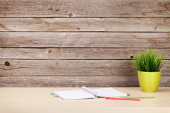 Office desk with supplies and plant Stock Photography