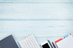 Office desk with supplies, smartphone and computer Royalty Free Stock Images