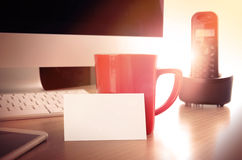 Office desk table with a blank business card Royalty Free Stock Photos