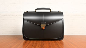 Office desk table with briefcase Royalty Free Stock Photo