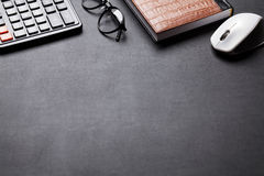 Office desk table with calculator, notebook and glasses Stock Images