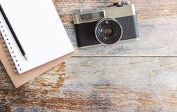 Office desk table with camera and notepad Stock Photography