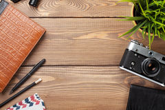 Office desk table with camera, supplies and flower Royalty Free Stock Image