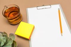 Office desk table with  clipboard colour sticker tea and succulent. Mock up template . Top view stock photo