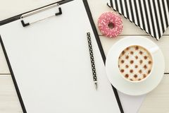 Office desk table with clipboard and cup of coffee stock images
