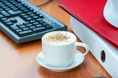 Office desk table with coffee cup and work essential tools Royalty Free Stock Photos