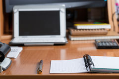 Office desk table with computer, calculator, supplies. Copy space for text.  Royalty Free Stock Photography