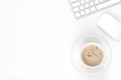 Office desk table with computer and coffee cup Stock Photo