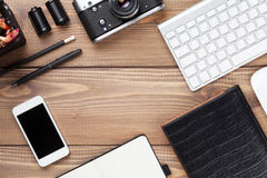 Office desk table with computer, supplies and camera Stock Photography
