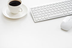 Office desk table with computer, supplies and coffee cup royalty free stock image