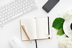 Office desk table with computer, supplies and coffee cup royalty free stock photo