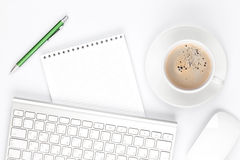 Office desk table with computer, supplies and coffee cup Royalty Free Stock Photos
