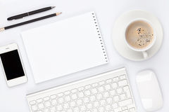 Office desk table with computer, supplies and coffee cup Royalty Free Stock Photography