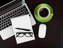 Office desk table with computer, supplies, coffee and glasses Stock Images