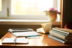 Office desk table with computer, supplies, flower. Copy space for text.  Royalty Free Stock Images