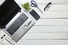 Office desk table with computer, supplies, flower Royalty Free Stock Photo