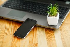 Office desk table with computer, supplies and plant.  royalty free stock photo